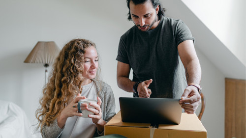 Woman and Man looking at a computer